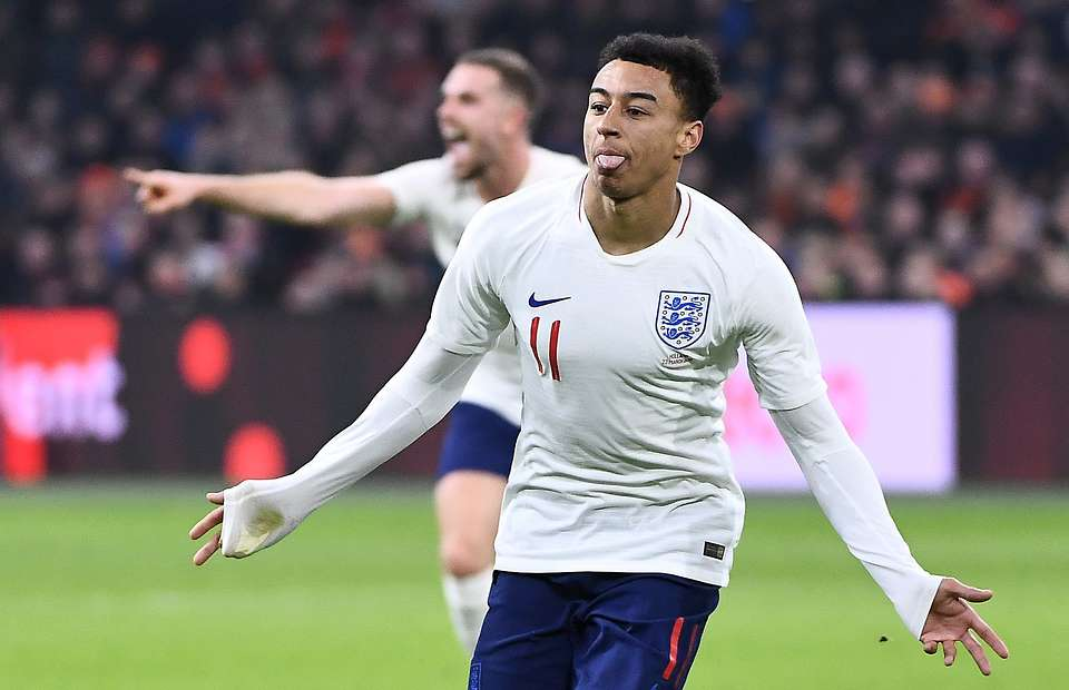 Jesse Lingard celebrates after scoring for England. (Getty Images)