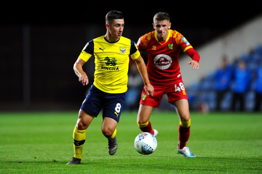 Cameron Brannagan of Oxford United turns with the ball under pressure from Reece McAlear of Norwich City during the Leasing.com Trophy match between Oxford United and Norwich City U21 at Kassam Stadium on September 03, 2019 in Oxford, England. (Getty Images)