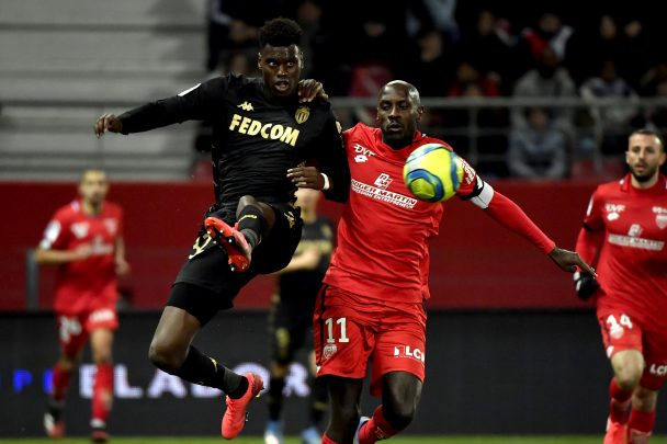 Monaco's French defender Benoit Badiashile (L) vies with Dijon's Cape Verdean forward Julio Tavares (R) during the Ligue 1 football match between Dijon FCO and AS Monaco on February 22, 2020 at the Gaston Gerard in Dijon France. (Getty Images)