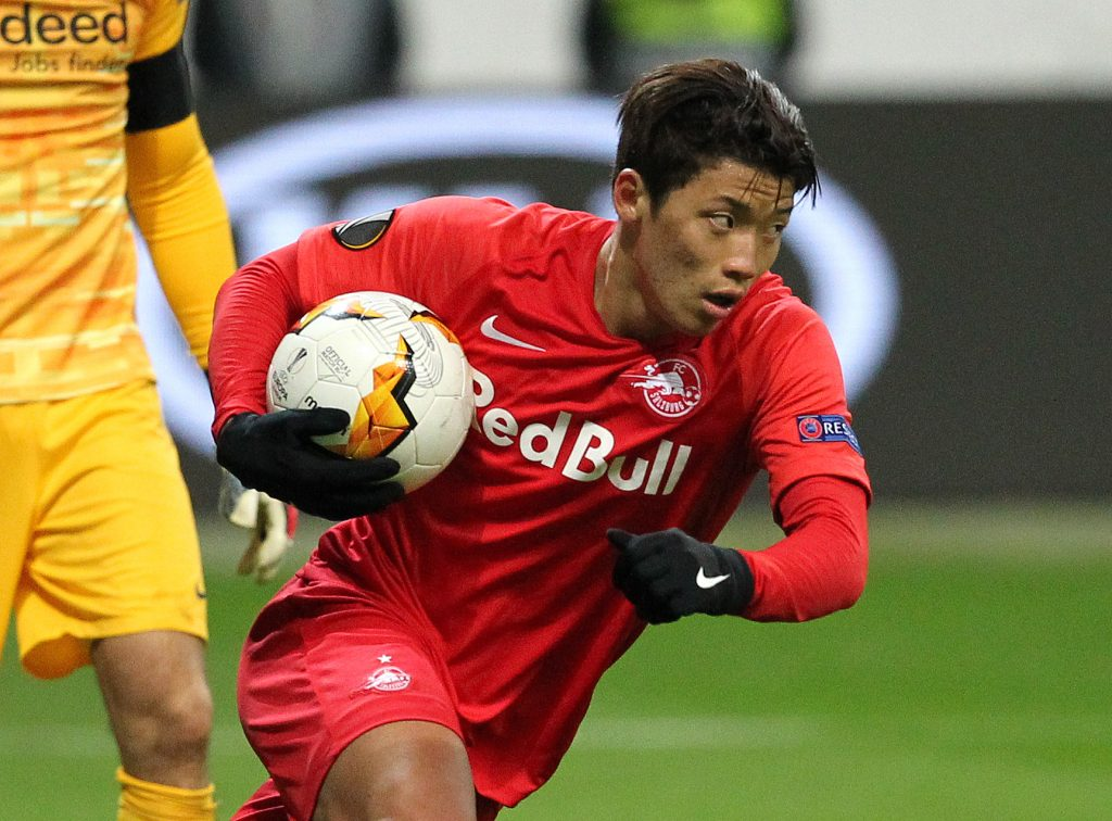 Salzburg's South Korean forward Hee-Chan Hwang runs with the ball after scoring the 4-1 from the penalty spot during the Europa League last 32 first leg football match between Eintracht Frankfurt and Salzburg. (Getty Images)