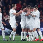 Leeds United players celebrate after a goal. (Getty Images)