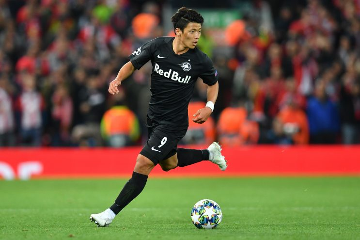 Salzburg's South Korean midfielder Hwang Hee-Chan runs with the ball during the UEFA Champions league Group E football match between Liverpool and Salzburg at Anfield in Liverpool. (Getty Images)