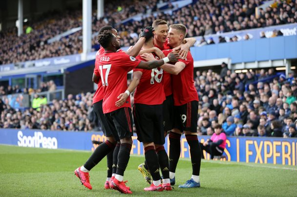 Manchester United players celebrate after scoring against Everton. (Getty Images)