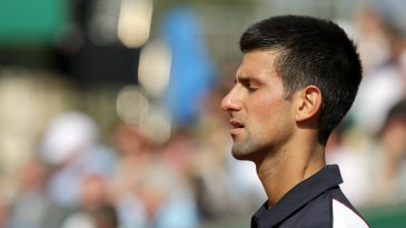 Novak Djokovic closing his eyes to meditate