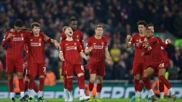Liverpool players celebrate in the Carabao Cup clash against Arsenal