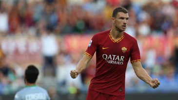 Edin Dzeko celebrates after scoring a goal for Roma (Getty Images)