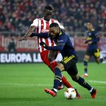 Ousseynou Ba of Olympiakos battles for possession with Alexandre Lacazette of Arsenal during the Europa League encounter between both the sides.