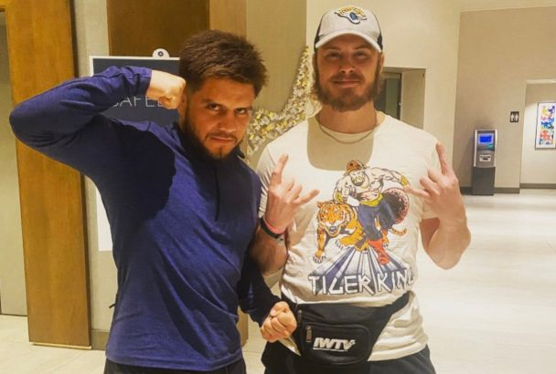Joey Janela poses with Henry Cejudo