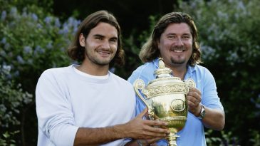 2003 Wimbledon men's singles champion Roger Federer of Switzerland poses with the trophy with his coach Peter Lundgren.