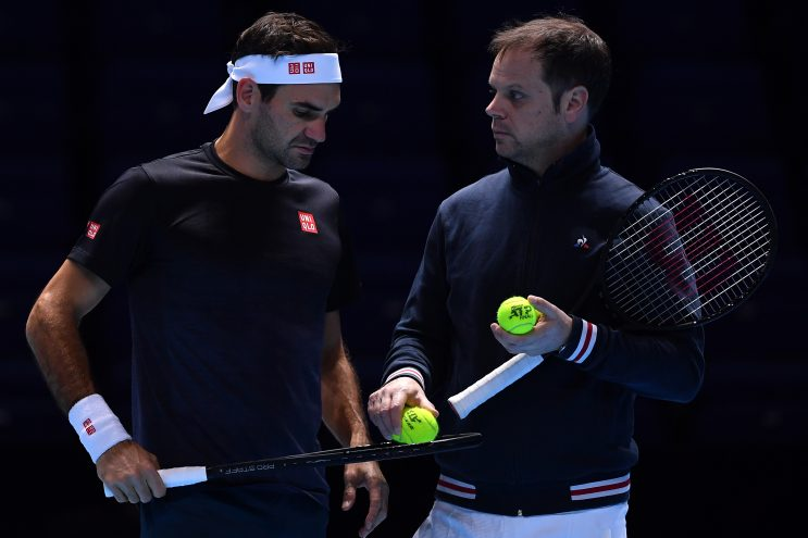 Roger Federer's coach Severin Luthi seen alongside the former during a practice session last year.
