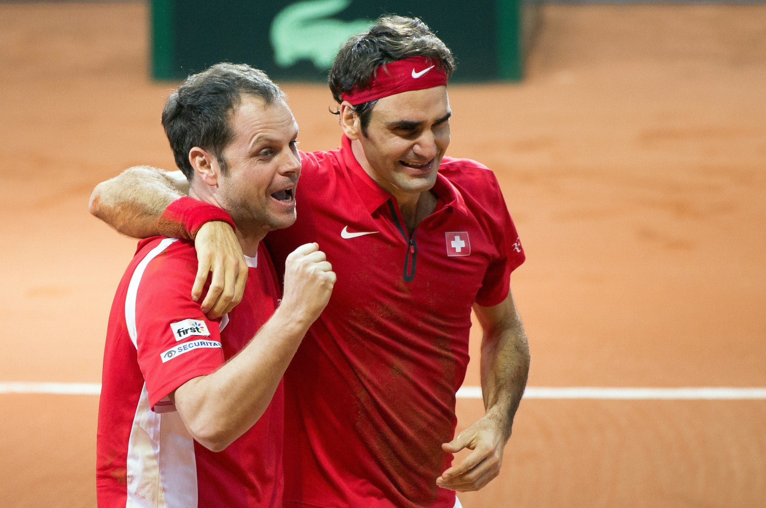 Roger Federer celebrates with Switzerland's Davis Cup team captain Severin Luthi after beating France's Richard Gasquet in their tennis match at the Davis Cup final in 2014.