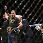 Justin Gaethje celebrates winning the UFC interim Lightweight title at 249