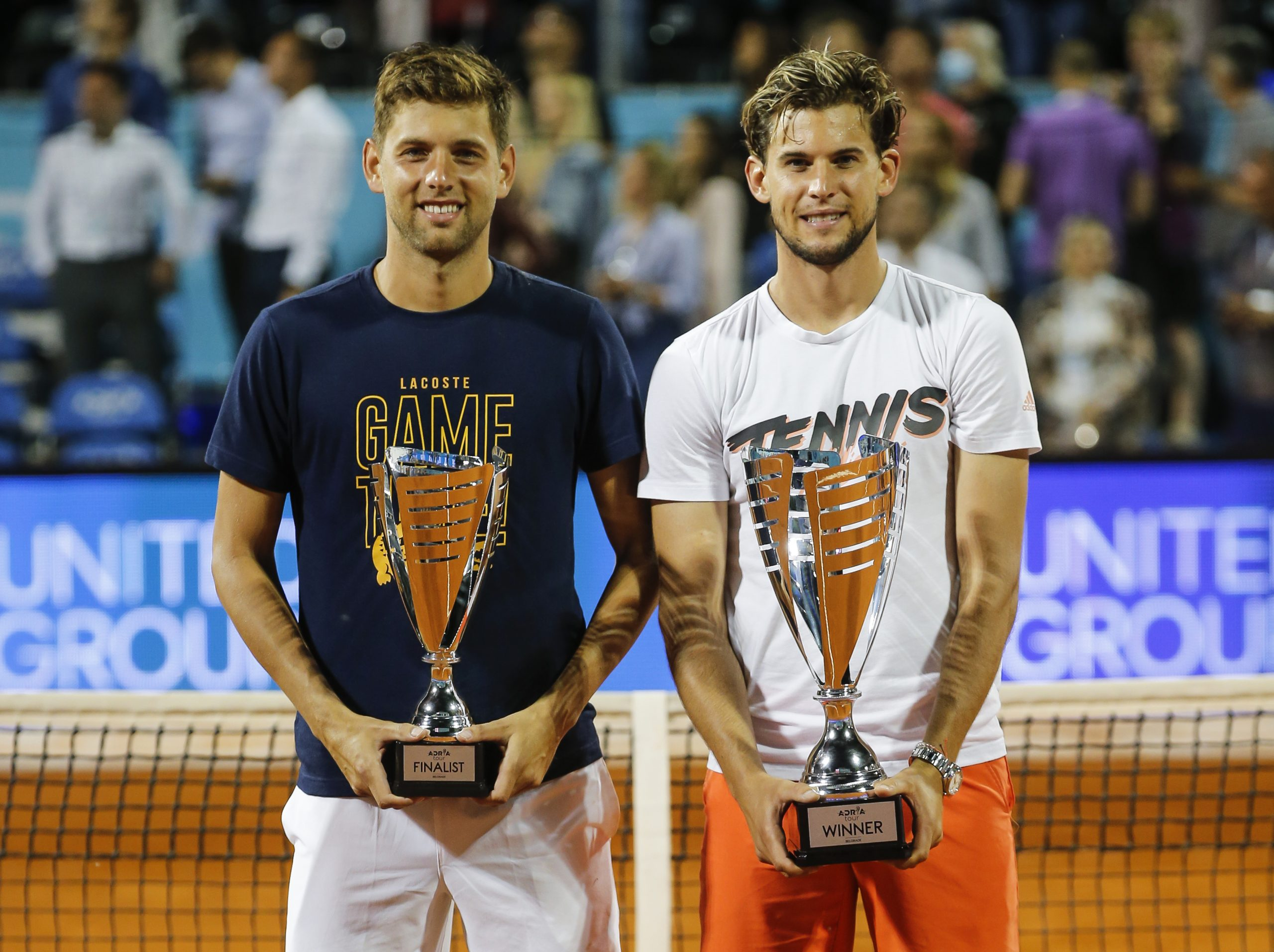 Dominic Thiem (right) of Austria and runner-up Filip Krajinovic (left) of Serbia pose with their trophies after the final match at the Adria Tour charity exhibition hosted by Novak Djokovic on June 14, 2020 in Belgrade, Serbia.