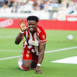 Sekou Gassama celebrates after scoring a goal while playing for Almeria in the Spanish second division.