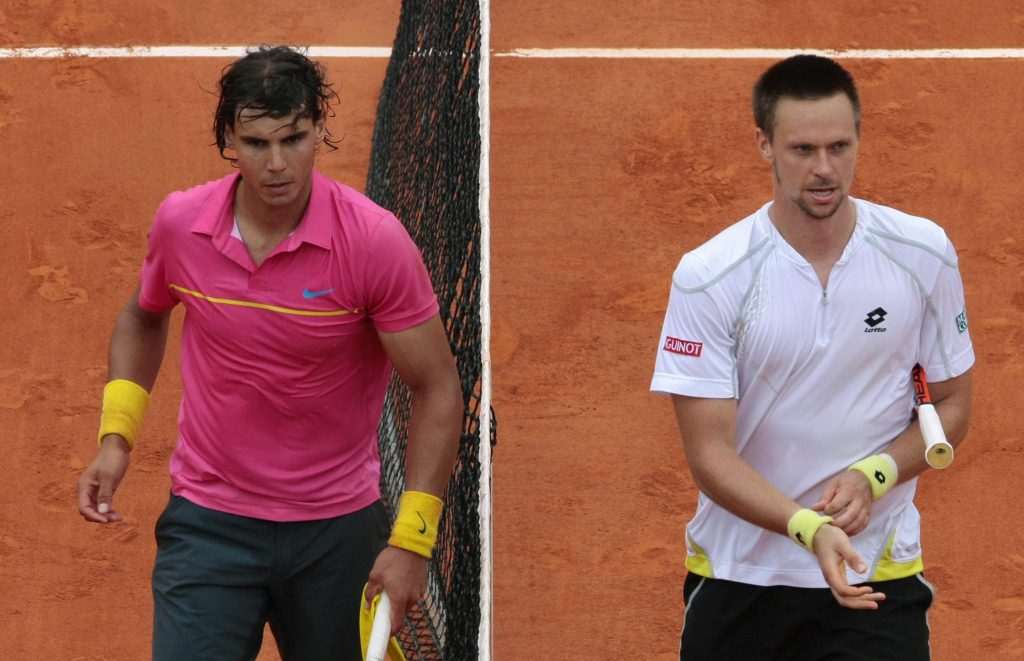 Spanish player Rafael Nadal (left) leaves the court after his fourth round loss to Swede Robin Soderling at the 2009 French Open.