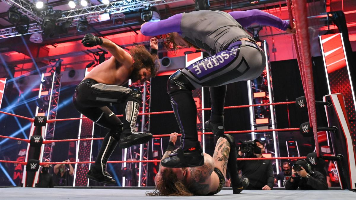 Seth Rollins and Murphy attack Aleister Black