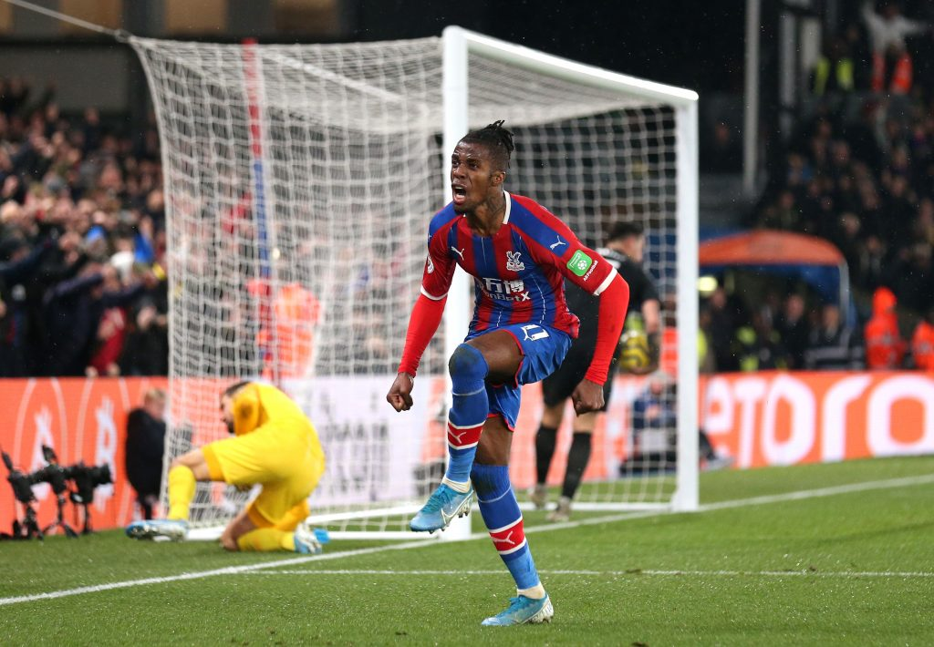 Wilfried Zaha celebrates after scoring a goal against Brighton in the Premier League (Getty Images)