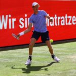 Jannik Sinner of Italy returns the ball to Tommy Haas of Germany during the quarterfinal exhibition match at the Steffi Graf Stadium in Berlin on Monday.