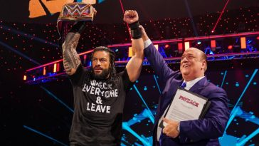 Roman Reigns celebrates winning the title with Paul Heyman
