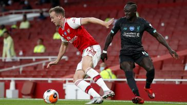 Rob Holding (L) in action against Liverpool (Getty Images)