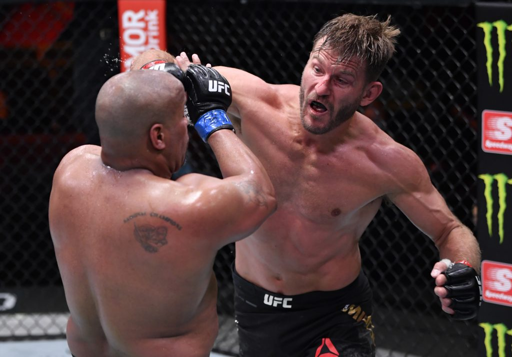 Stipe Miocic (R) punches Daniel Cormier in their UFC heavyweight championship bout during the UFC 252 event.