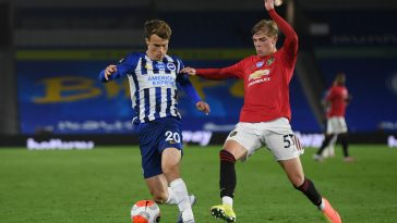 Solly March (L) in action against Manchester United (Getty Images)