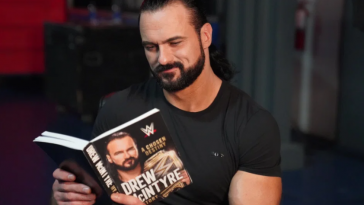 Drew McIntyre pictured reading his book, 'A Chosen Destiny'.