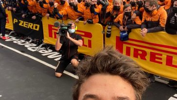 Lando Norris celebrates with the McLaren team at Imola 2021