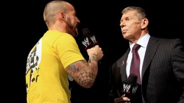 CM Punk with Vince McMahon during his time at WWE.